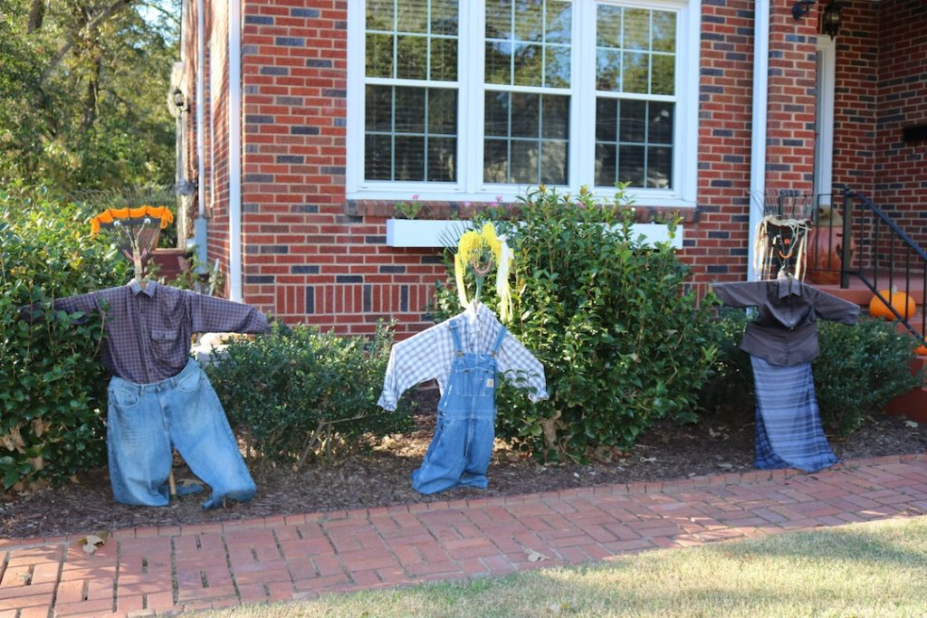 Scarecrow family made of rakes