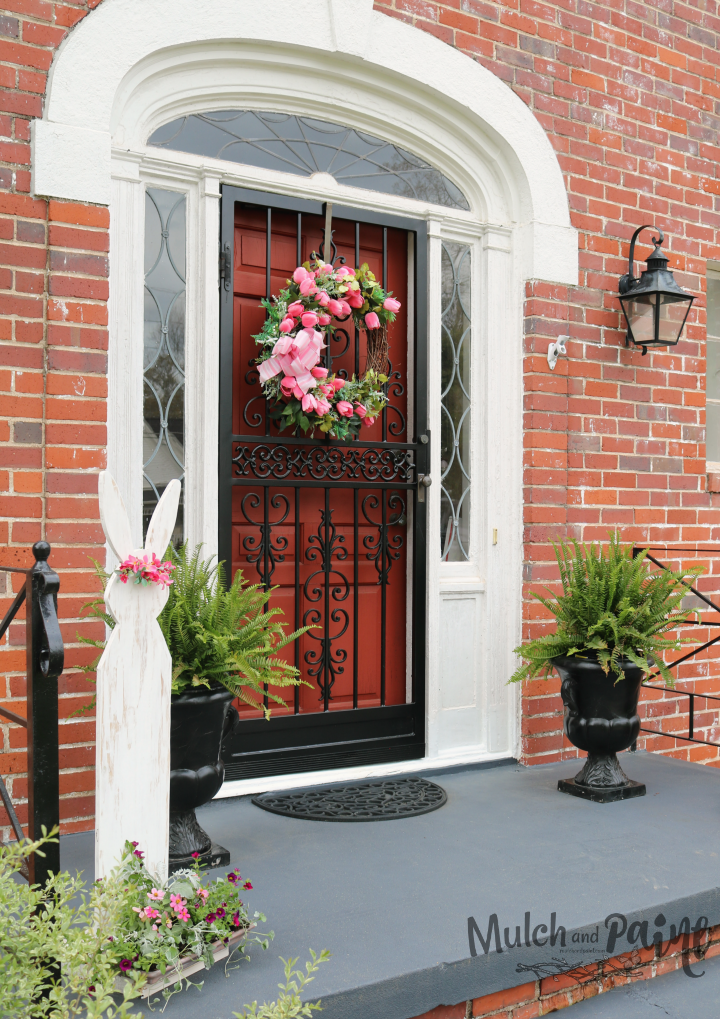 Easter front porch with pink tulip wreath
