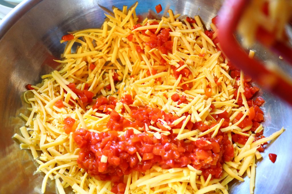 Grated cheddar cheese and pimientos