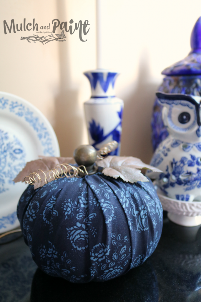 Halloween tablescape with Dollar Tree eyeballs in a cloche