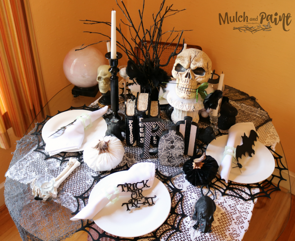 Halloween table decorations with skulls and bats