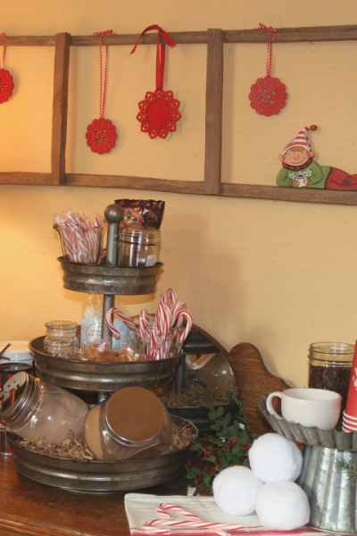 Hot Cocoa Bar set up with Elf and red snowflakes