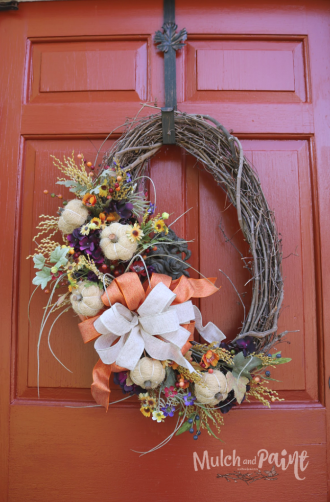 Fall front door wreath with white pumpkins