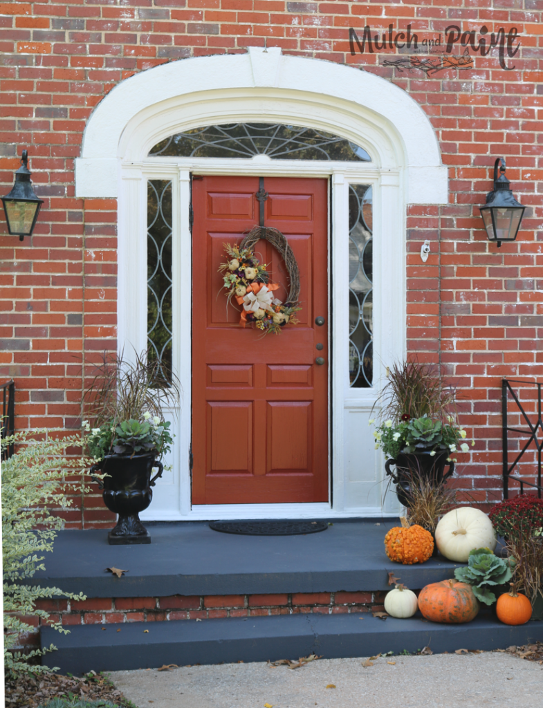 Fall front porch decor with pumpkins and mums