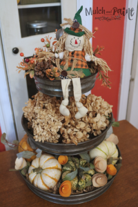 Fall tiered tray decorations with pumpkins and dried hydrangea