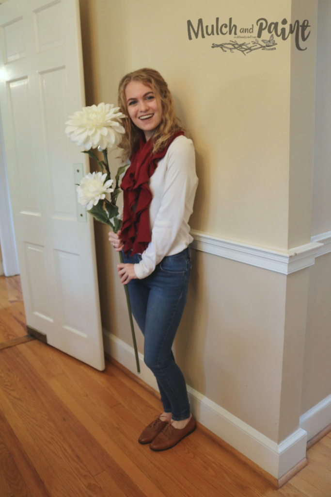 Mary posing with large flower for Harry Potter flying keys